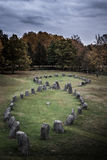 Ancient burial ground in Anundshög. View of a pre historic burial ground in Sweden. Within the grave-field area there are many standing stones. Located in Stock Image