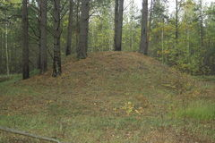 An ancient burial mound Stock Images
