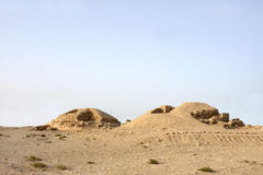 Ancient burial mounds in Saar village, Looking NE. The burial mounds in the Saar village dates from the early Dilmun period of 4000 years ago Royalty Free Stock Image