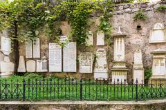 Ancient burial tombstones affixed to the walls at the Cathedral of Meran Stock Images