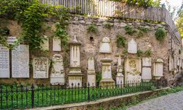 Ancient burial tombstones affixed to the walls at the Cathedral of Meran Royalty Free Stock Photos