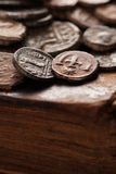 Ancient byzantine copper coins on the old book Stock Photography