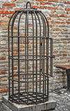 Ancient cage. Ancient rusty cage on a cement platform Royalty Free Stock Photos