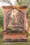 Ancient Cambodian king sculpture on brick wall. In Thai botanic garden Stock Photography