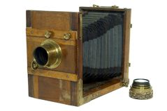 Ancient camera with a bellows lens royalty free stock photos