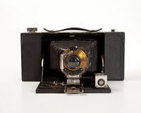 Ancient Camera in front view. Antique bellows camera in front view isolated on white stock images