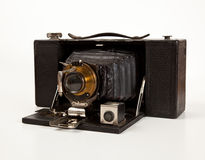 Ancient Camera in front view. Antique bellows camera in side view isolated on white royalty free stock photo