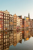 Ancient canal houses in the Dutch capital city Amsterdam Stock Images