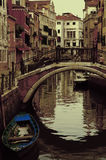 Ancient canal in Venice. With colored boat stock image