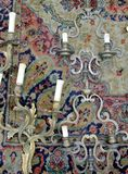 Ancient candelabrum. The ancient candelabrum on a carpet Royalty Free Stock Images