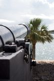 Ancient cannon. On fort wall overlooking harbor. St. Augustine, Florida royalty free stock images