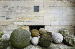 Ancient cannon balls on display in Papal Palace in Avignon, France Stock Image
