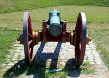 Ancient Cannon with cannonballs. Ancient Cannon and a pile of cannonballs at the Kastellet fortification in Copenhagen, Denmark royalty free stock image