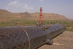 Ancient Cannon at Daulatabad Fort, India. Ancient Muslim cannon on the battlements of Daulatabad Fort, India. 14th Century AD stock photography