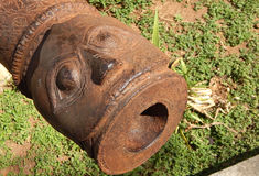 Ancient cannon with head of a man engraved in the bod Stock Photo