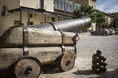 Ancient cannon and iron cannonballs Royalty Free Stock Photo