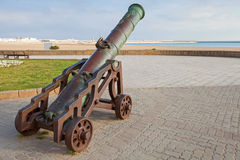 Ancient cannon stands on the beach in Tangier. Morocco stock photo