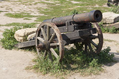 Ancient cannon on wheels photo Stock Photography