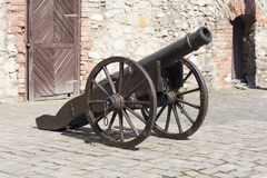 Ancient cannon on wheels photo Stock Images