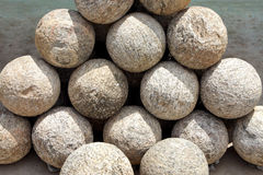 Ancient Canon balls made of granite rock Royalty Free Stock Photography