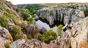 Ancient canyon, the miracle in the Ukrainian steppe. The natural wonder, the huge rocks and stones. Royalty Free Stock Photo
