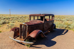 Ancient car alone in the Desert. Stock Photo