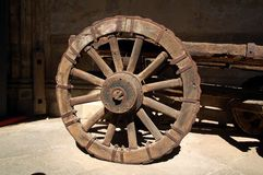 Ancient car wheel. Wheel of ancient car exposed in the cloister of the Cathedral of Toledo, Spain Stock Images