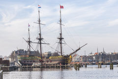 Ancient cargo ship in Amsterdam. The Amsterdam - a replica of an 18th-century cargo ship of the Dutch East India Company. Stationed at the Netherlands Maritime Stock Images