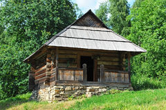 Ancient carpatian hut in forest Royalty Free Stock Photo