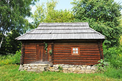 Ancient carpatian hut in forest Stock Images