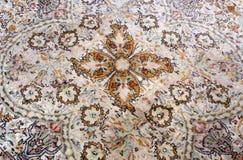 Ancient carpet. Detail of brown ancient carpet royalty free stock photos