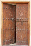 Ancient carved door with bolts, Riffa fort Bahrain Royalty Free Stock Images