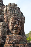 Ancient carved face in Angkor Wat Royalty Free Stock Photos