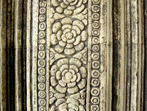 Ancient carved floral pattern. Pattern of floral. Ancient carved floral pattern design on sandstone of door frame at Angkor Wat is a world heritage of Siem Reap Stock Photo