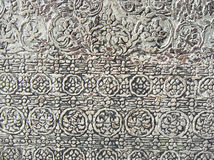Ancient carved floral pattern. Pattern of floral. Ancient carved floral pattern design on sandstone of door frame at Angkor Wat is a world heritage of Siem Reap Stock Photos