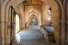 Ancient carved wall with hindu deities in Hazara Rama Jain Templ Royalty Free Stock Image