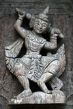 Ancient carved wooden figure at Shwe Nan Daw Kyaung, Myanmar Stock Image