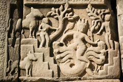 Ancient carving of Varuna the Hindu God of Storms Stock Photos