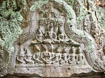 Ancient carving on the wall of Prasat Ta Prum Temple, Cambodia. Royalty Free Stock Photos
