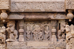 Ancient carvings with dancing women in Indian style, on ceremonial cart of Hindu temple. Old structure in India Royalty Free Stock Image