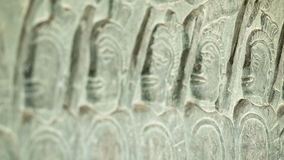Ancient carvings on the walls of Angkor Wat close up. Cambodia, 12th century Stock Photos