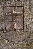 Ancient Roman Carvings. Ancient carvings in the walls in Rome showing  a cross resting on what appears to be the arc Royalty Free Stock Photos