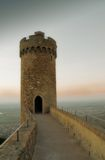 Ancient castle. Sunset behind tower of ancient castle Stock Image