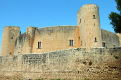 Ancient castle against blue sky in Mallorca. Ancient medieval castle against blue sky in Mallorca Stock Photography