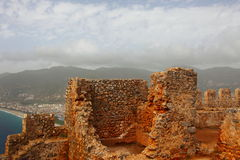 Ancient Castle in Alania. Ruins of an ancient castle with backdrop view of the city of Alania Stock Photo