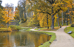 Ancient castle and autumnal park Stock Photos