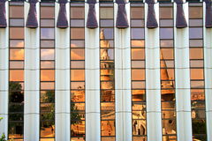 Ancient castle Fishermen`s bastion reflected in the mirror facade of a building. Royalty Free Stock Photo