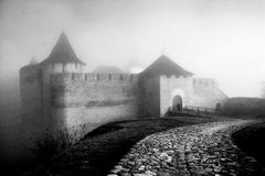 Ancient castle in a fog. BW image of ancient castle in a fog. Middle Europe, Khotyn Stock Image