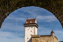 An ancient castle framed in an arch royalty free stock image