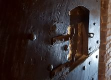 Ancient castle jail door. Wood ancient castle jail door with metal parts in italian castles stock photos
